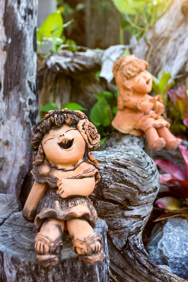 Download Smiley Clay Doll On Wood In The Park. Stock Photo - Image of cartoon, color: 39510560