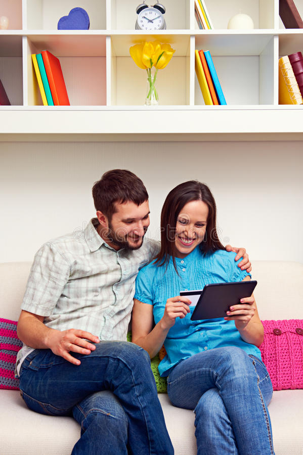 Download Smiley Couple Shopping On The Internet Stock Photo - Image: 29731114