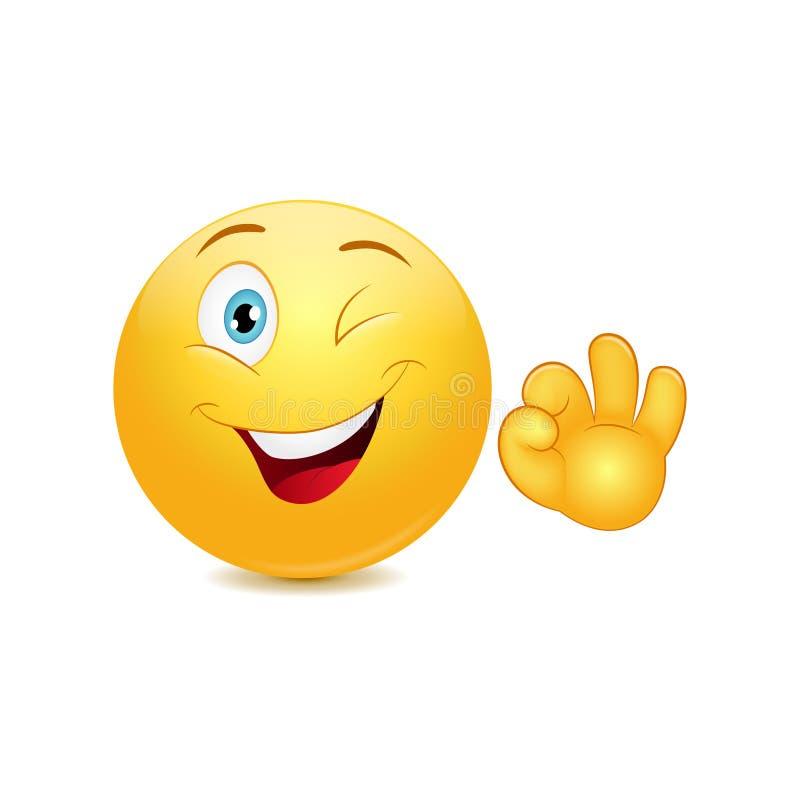 Smiley emoticon met o.k. teken stock illustratie