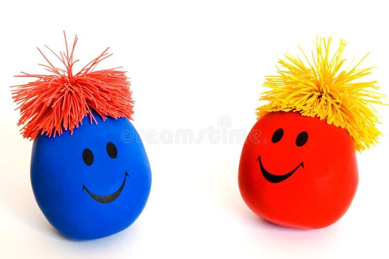 smiley för 3 färgrik framsidor arkivfoton
