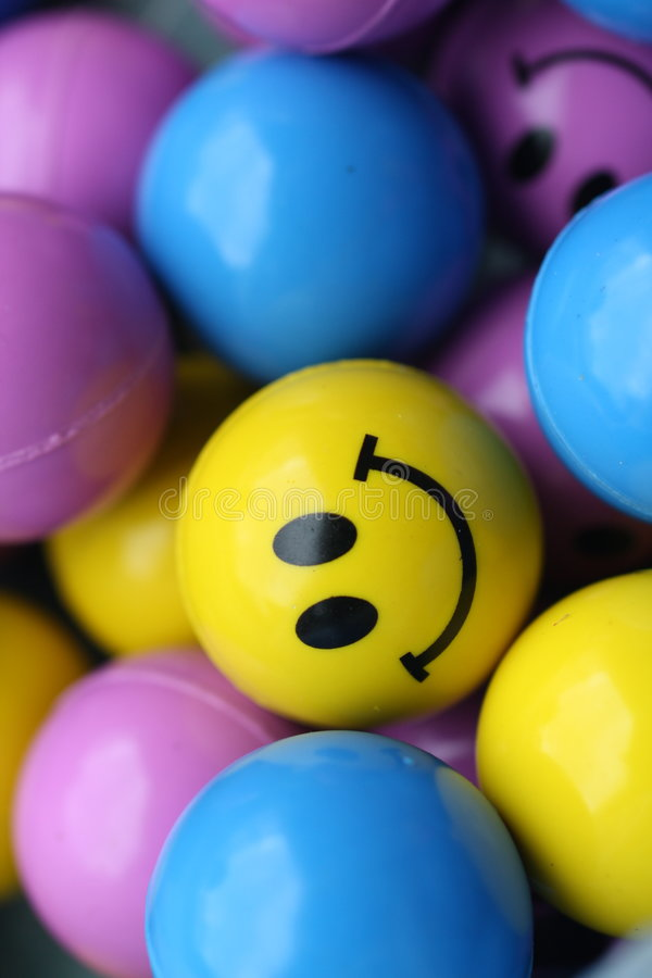 Smiley Face Ball. Smile Face Balls with an on looker. Looking from afar royalty free stock photos