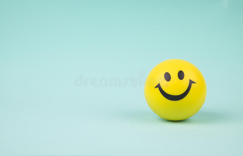 Smiley face ball on background sweet retro vintage color. Yellow laughing happy smile face. Smiley face ball on background sweet retro vintage color royalty free stock photo