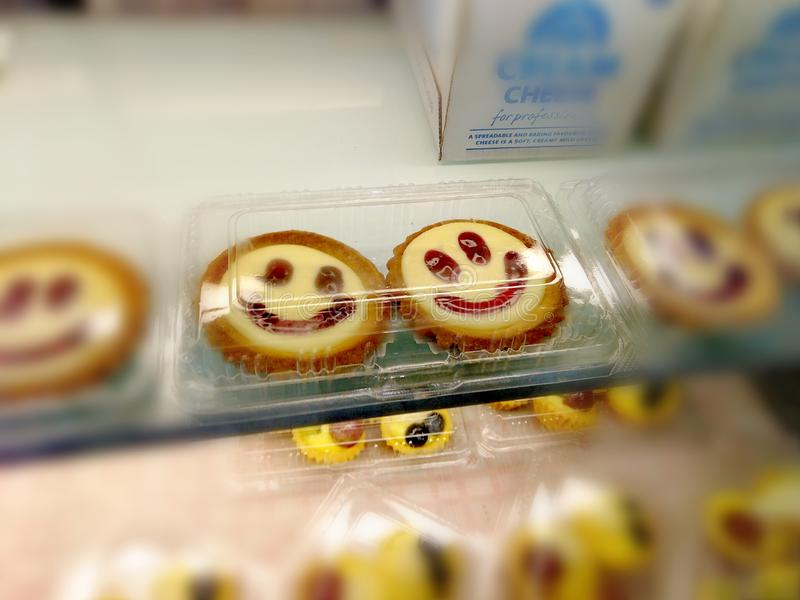 Smiley face egg tarts in a bakery royalty free stock images