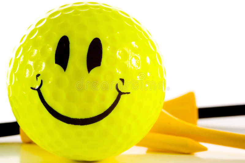 Smiley face golf ball on white background stock photo