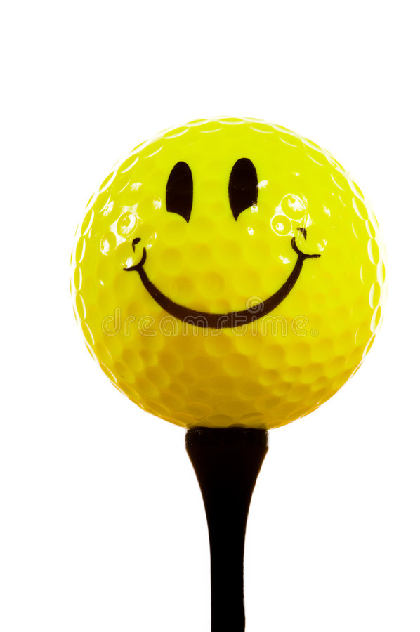 Smiley face golf ball on white background. Yellow smiley face golf ball on white background with tee, idea is that golf provides happiness stock images