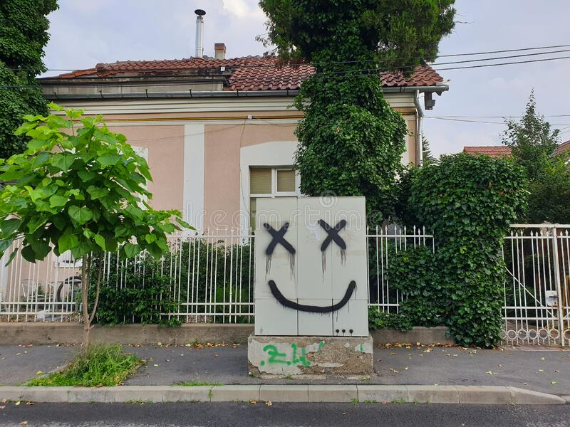 Smiley face graffiti painted art in Cluj-Napoca stock photo
