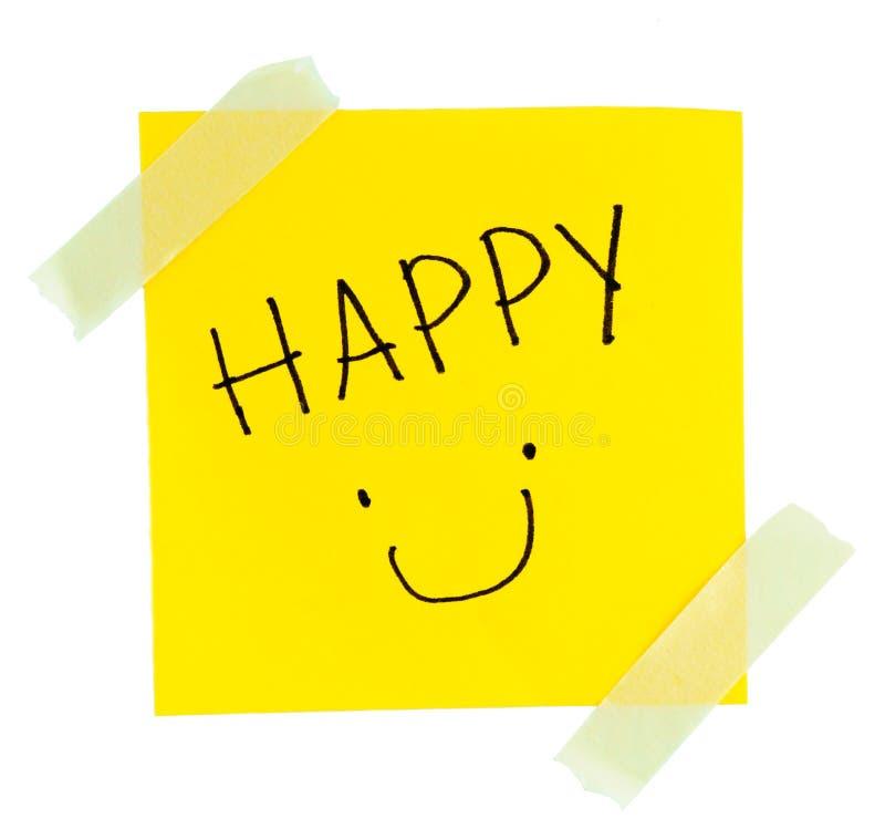 Smiley Face gul klibbig anmärkning arkivbilder