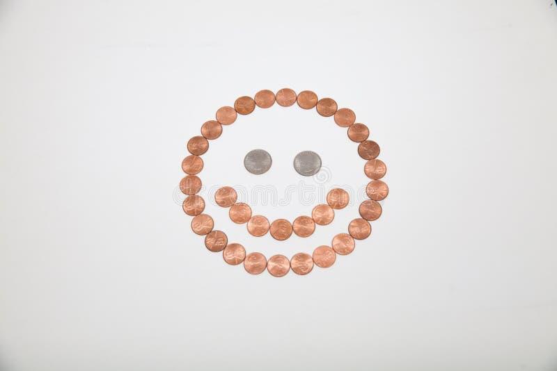 Smiley Face machte von den Münzen stockfotos