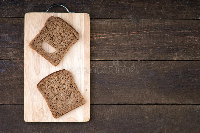 Smiley face made from bread royalty free stock images