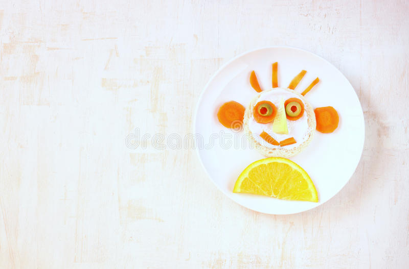Smiley face made of fruits and vegetable stock image