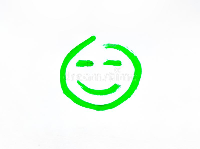 Smiley face with a smile painted on paper. Joyful and smiling smiley green painted with gouache and brush stock photography
