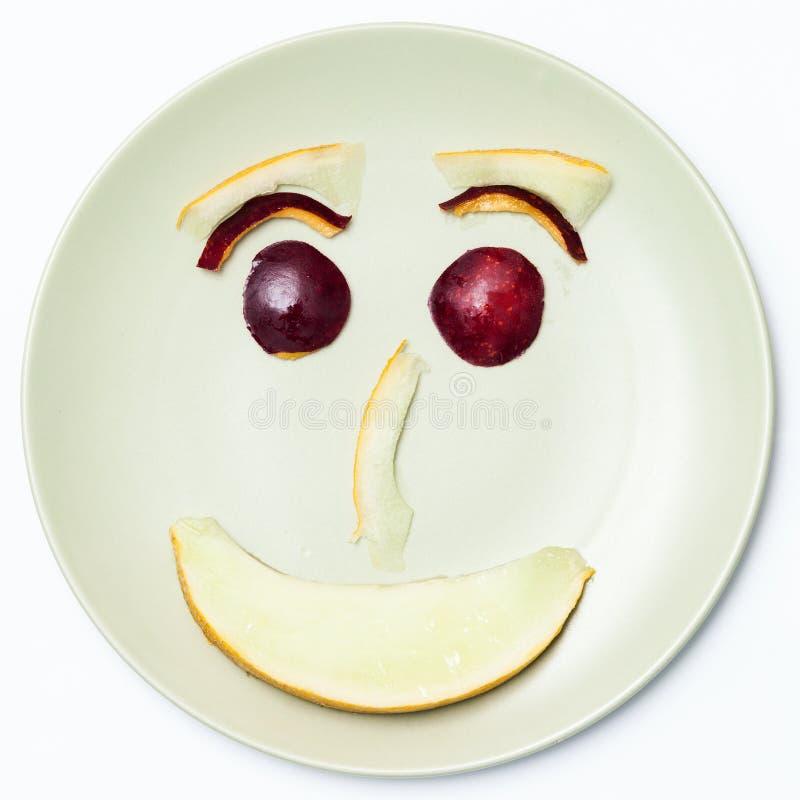 Smiley Face som göras med nektariner och melon royaltyfria foton