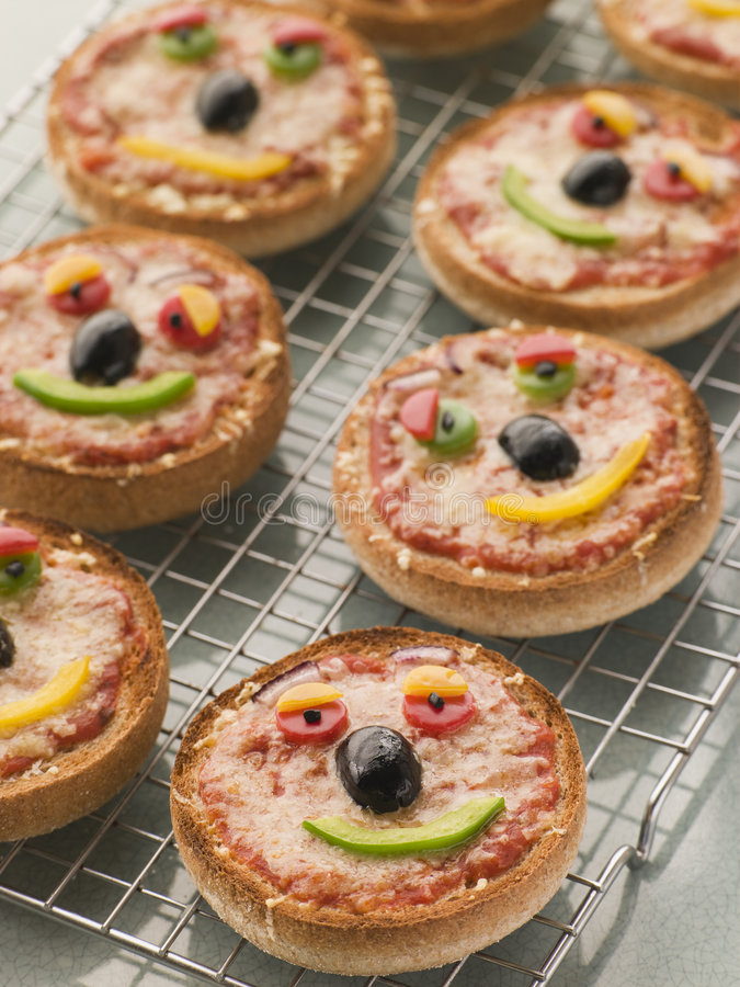Download Smiley Faced Pizza Muffins stock photo. Image of recipe - 5858288