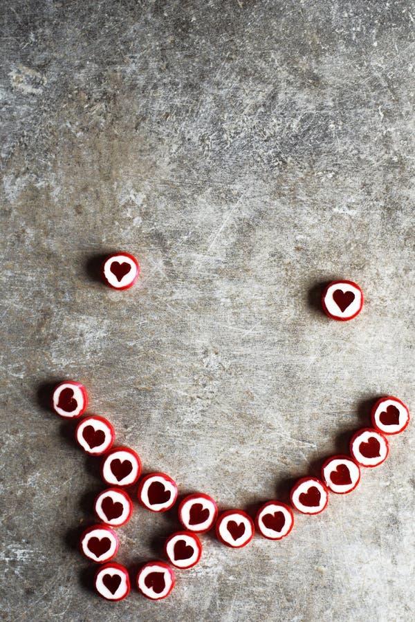 Smiley fait de sucreries de coeur images stock
