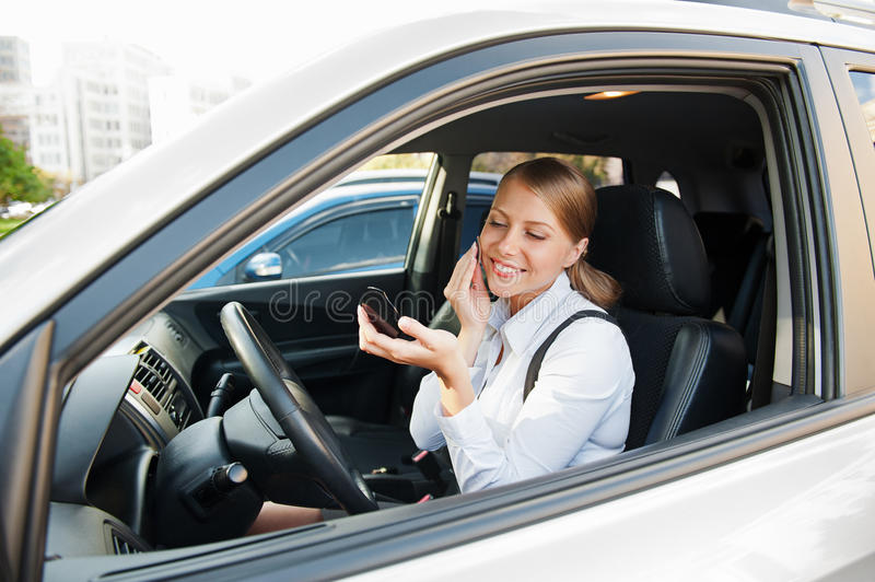 Smiley Female Sitting In The Car Royalty Free Stock Images