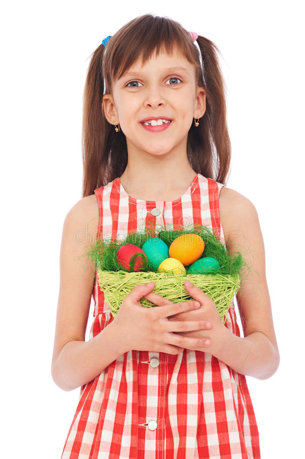Download Smiley Girl Holding Basket With Colorful Eggs Stock Photo - Image: 18788596