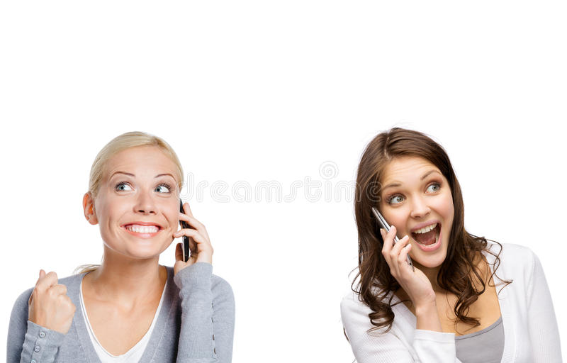 Smiley girls speaking on phone royalty free stock image