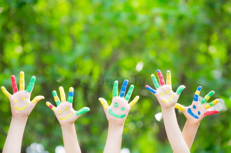 Smiley hands. Group of smiley hands against green spring background