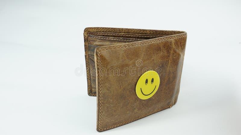 Smiley Happy Face piskar plånboken som isoleras på vit bakgrund royaltyfri foto