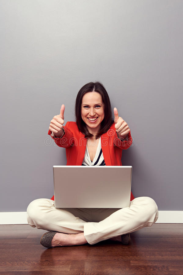 Download Woman With Laptop Giving Thumbs Up Stock Photo - Image of computer, sitting: 30128982