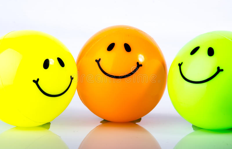 Smiley icon. Painted on a colored ball captured on the egg tray stock images