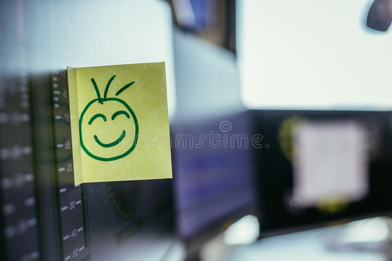 Smiley illustration at the working place, metaphor for feedback and motivation. Feedback and motivation concept: Smiley Illustration at the working place, happy royalty free stock photos