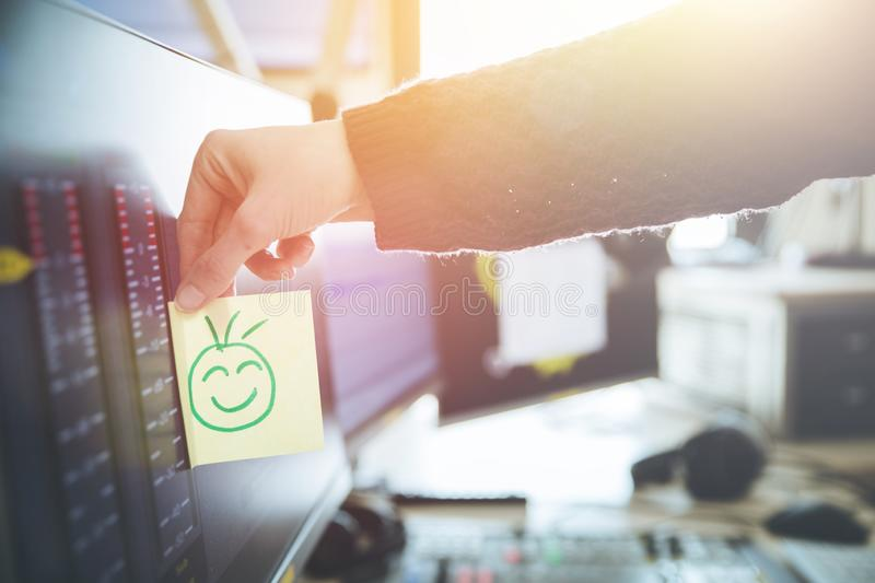 Smiley illustration at the working place, metaphor for feedback and motivation. Feedback and motivation concept: Smiley Illustration at the working place, happy royalty free stock photo