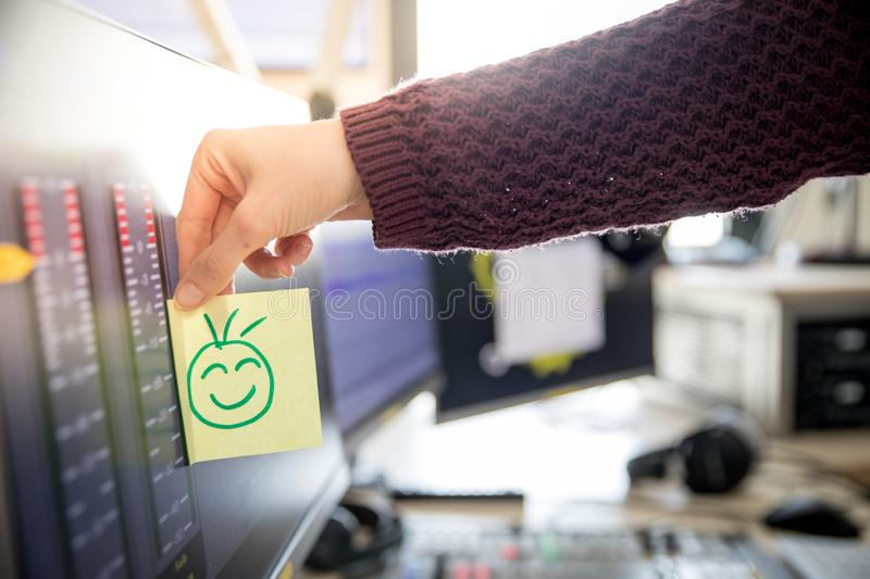 Smiley illustration at the working place, metaphor for feedback and motivation. Feedback and motivation concept: Smiley Illustration at the working place, happy royalty free stock images
