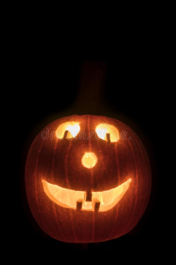 Smiley Jackolantern. A lit jackolantern with a smiley face royalty free stock image