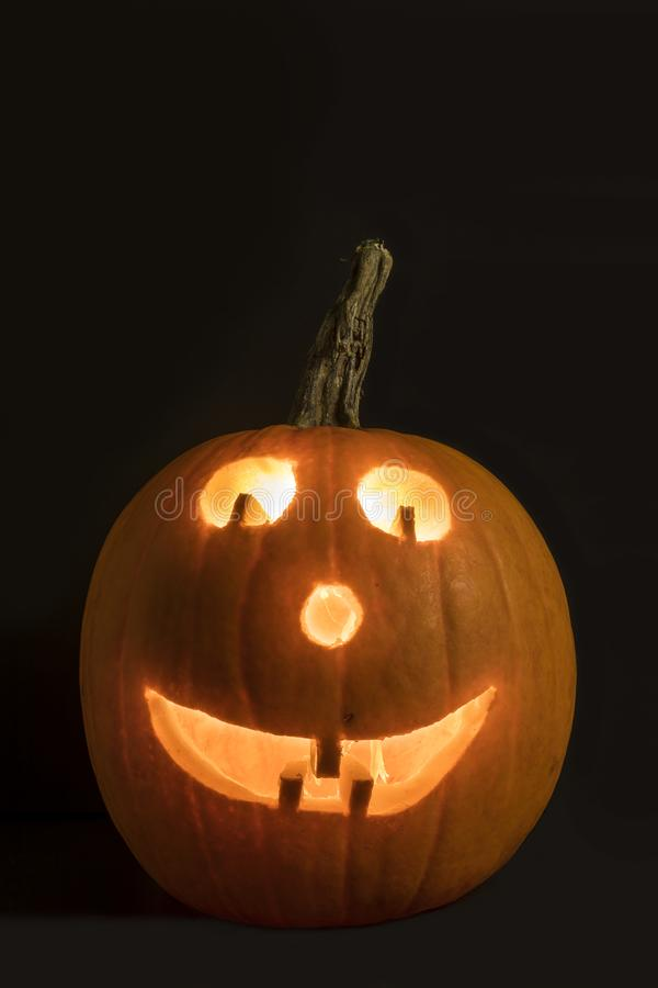 Smiley Jackolantern. A lit jackolantern with a smiley face stock photo