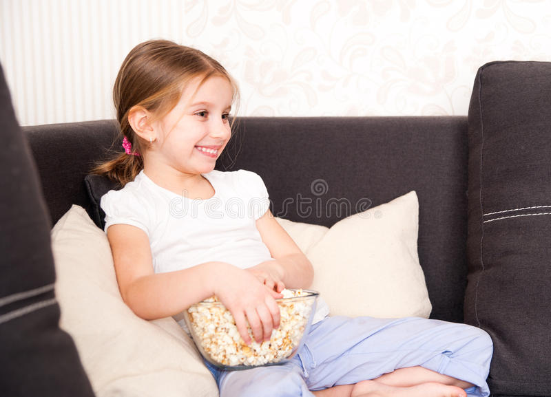 Download Little girl watching TV stock image. Image of caucasian - 30120291