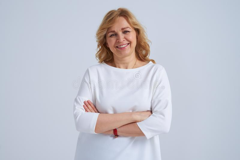 Smiley mature woman posing stock images