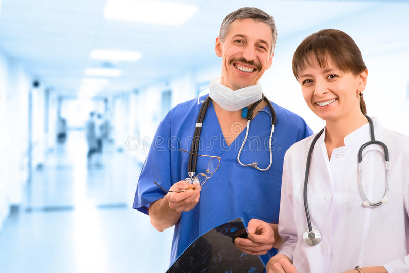 Smiley medical team. Three male and female doctors stock images