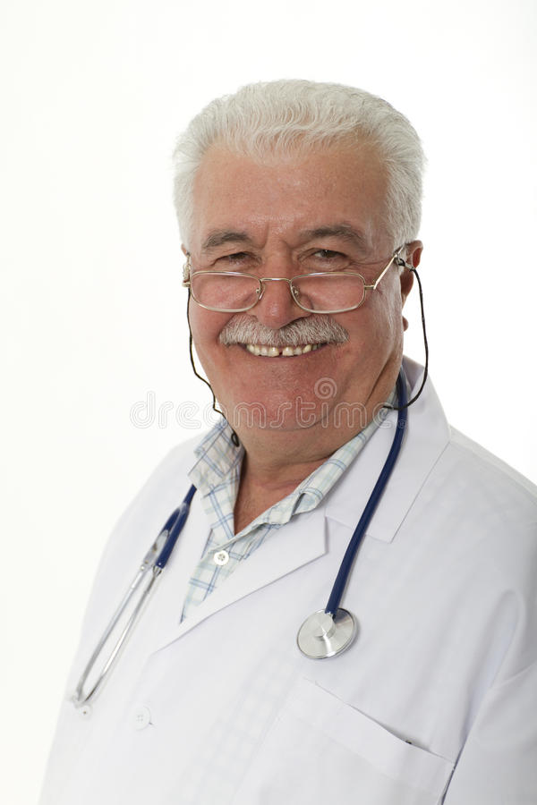 Smiley Older Doctor. An experienced older Doctor smiling royalty free stock photos