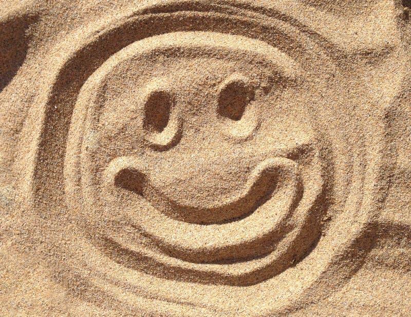 Smiley piaska twarz fotografia stock