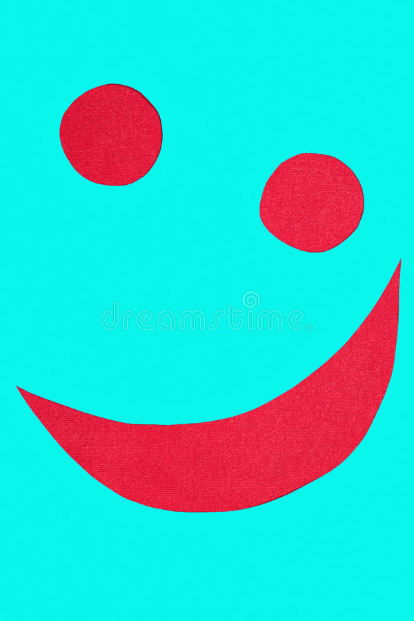 Smiley on red fabric stock photo