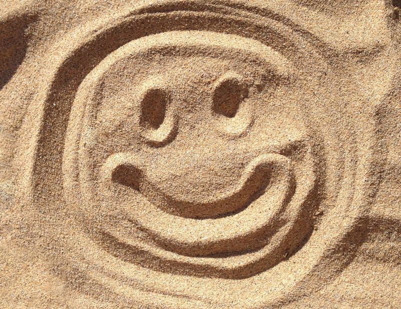 Smiley Sand Face photographie stock