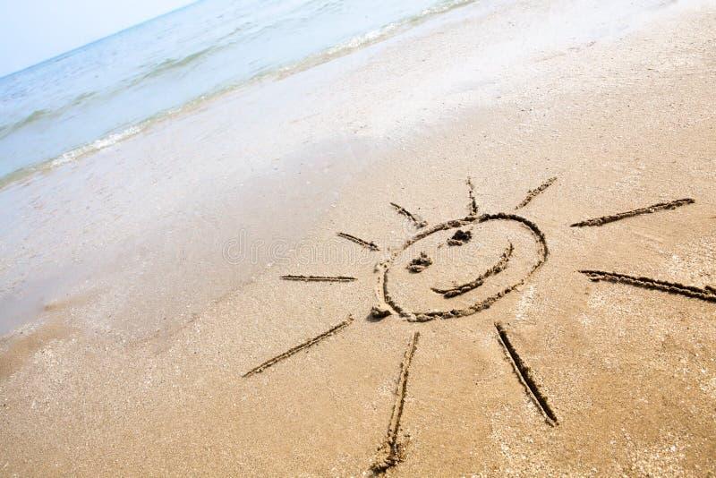 Smiley Sun On The Beach stock photography