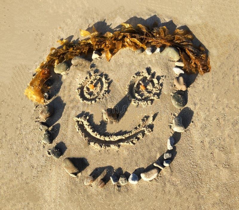Smiley twarz Rysująca W piasku fotografia royalty free