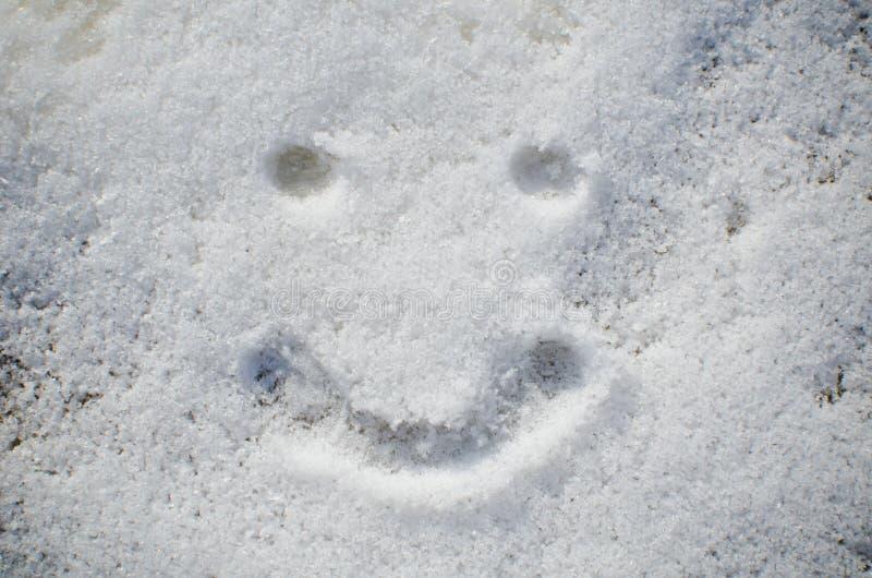 Smiley twarz w śniegu obraz stock