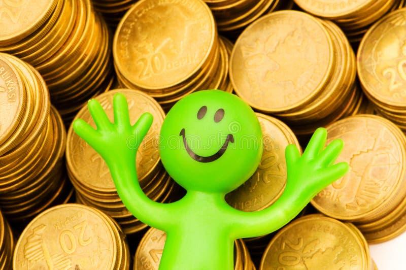 Smiley und Münzen getrennt stockfotografie