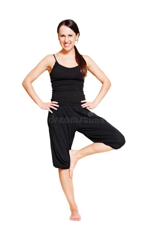 Smiley woman in asana royalty free stock photo