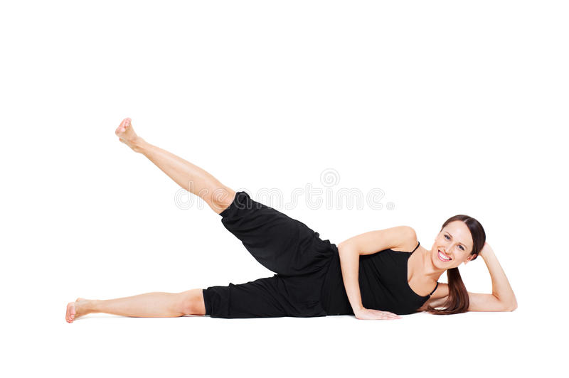 Smiley woman doing exercise royalty free stock photo