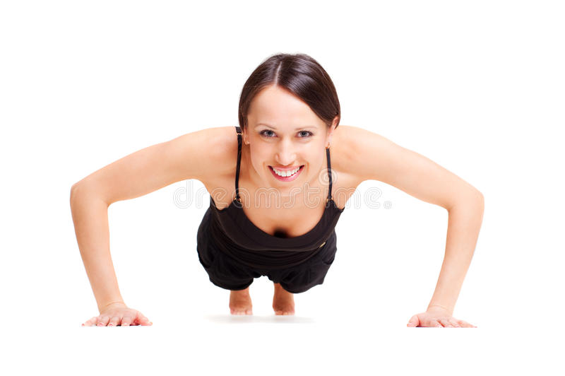 Smiley woman doing press up royalty free stock photo