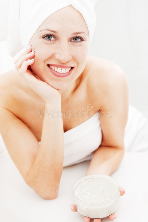 Smiley Woman With Face Cream After Shower Royalty Free Stock Photo