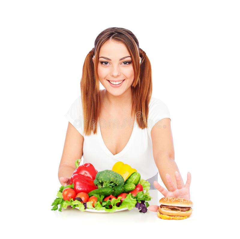 Smiley woman with vegetables and burger royalty free stock images