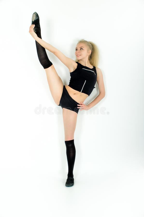 Smiley young sportswoman doing stretching exorcises. isolated on white background stock photography