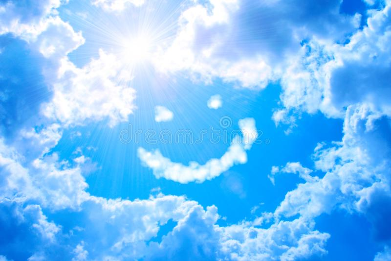 Smilie from cloud and bright sun in blue sky stock image