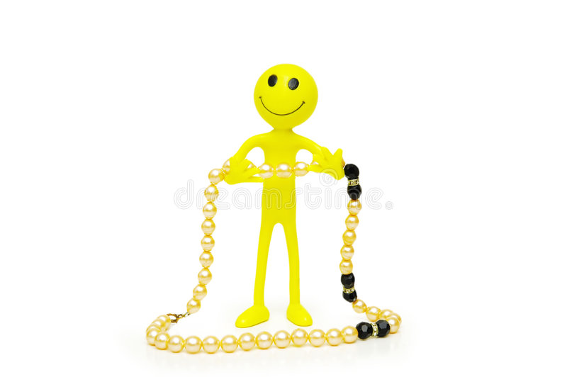 Smilies and pearl necklace stock image
