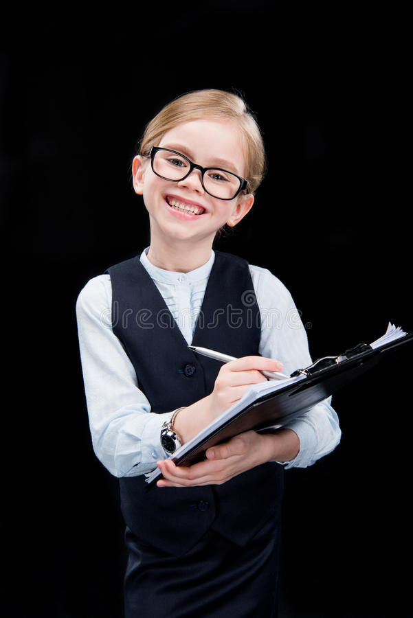 Smiling adorable girl with folder royalty free stock photography